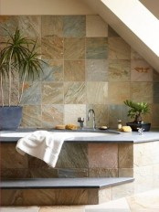 surround your bathtub with potted plants to make the space look and feel more natural and fresh