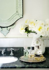 some neutral blooms in an elegant vase make any bathroom refined, chic and very welcoming