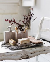 put some bold branches into a bathroom organizer to make the space feel more chic and more spa-like
