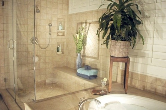 a neutral bathroom with potted greenery in the shower and tub zone, it will refresh any space at once