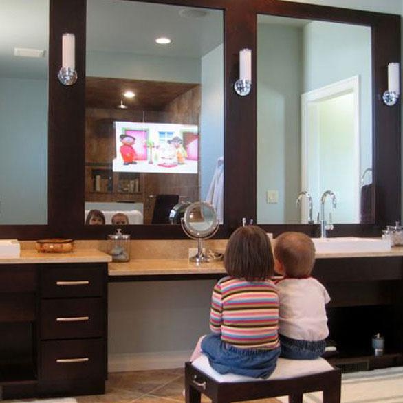 Tv in mirror bathroom