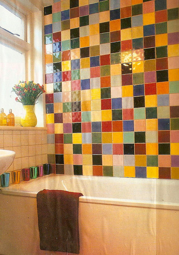 Bathroom With A Wall Tiled In Bunch Of Colors