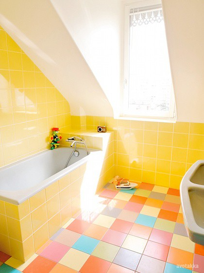 Bathroom With Yellow Walls And Colorful Floors