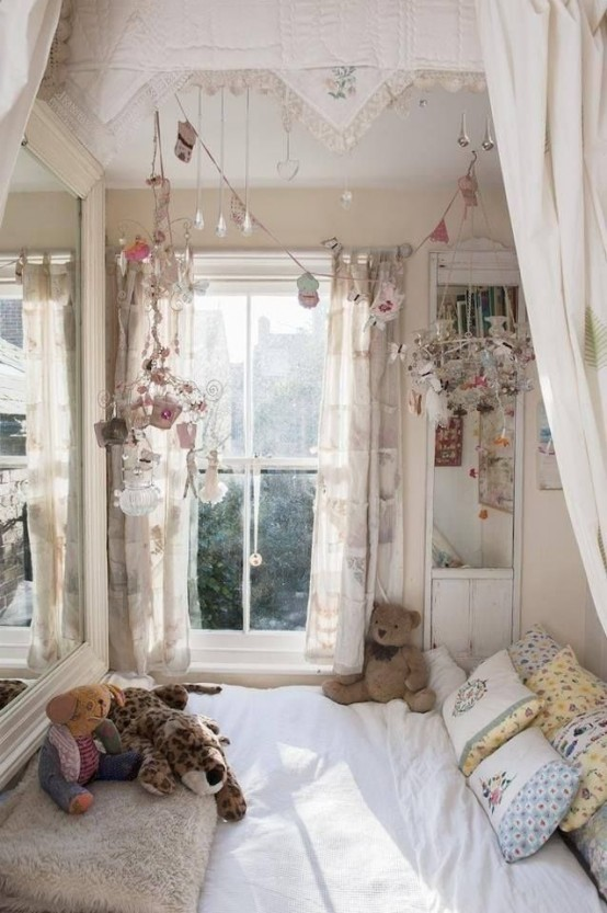 a neutral shabby chic kid's room with a bed by the window, floral bedding and lots of vintage items hung over the bed as decor
