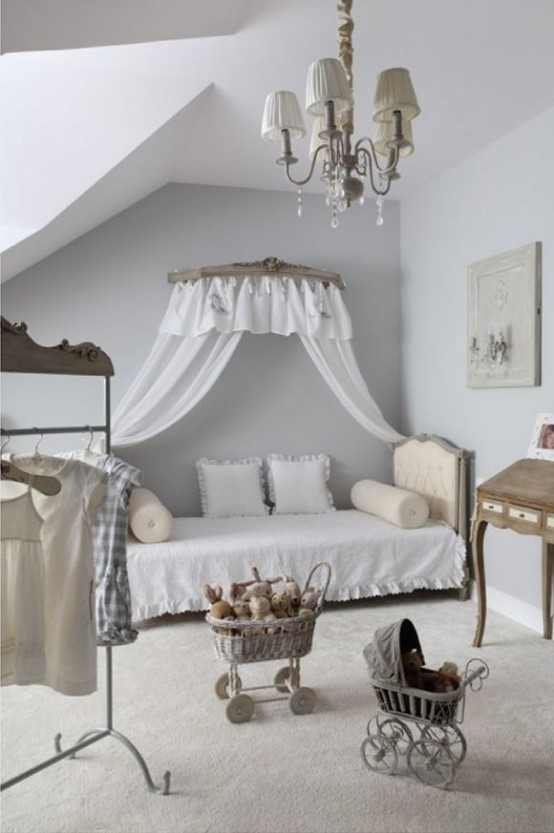 a refined neutral vintage to shabby chic bedroom with white walls and white exquisite furniture, a chic chandelier, an open closet and some vintage toys