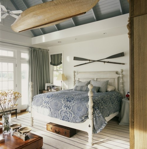 If you wish to go bold then hang a bout in your bedroom. Traditional wooden oars are also a great addition.