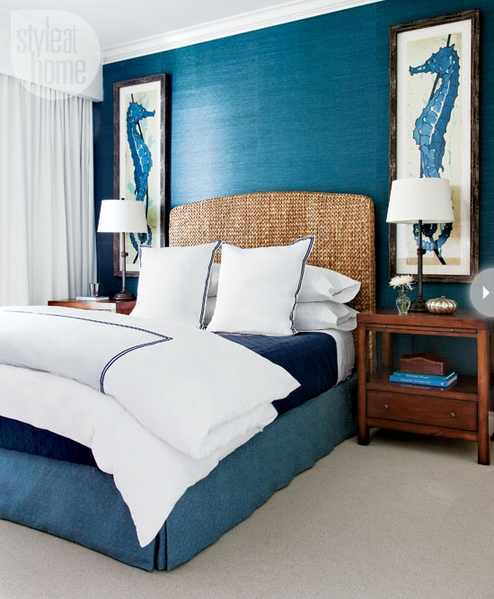 Awesome shade of blue is combined with oversized pictures of sea horses in this gorgeous bedroom design.