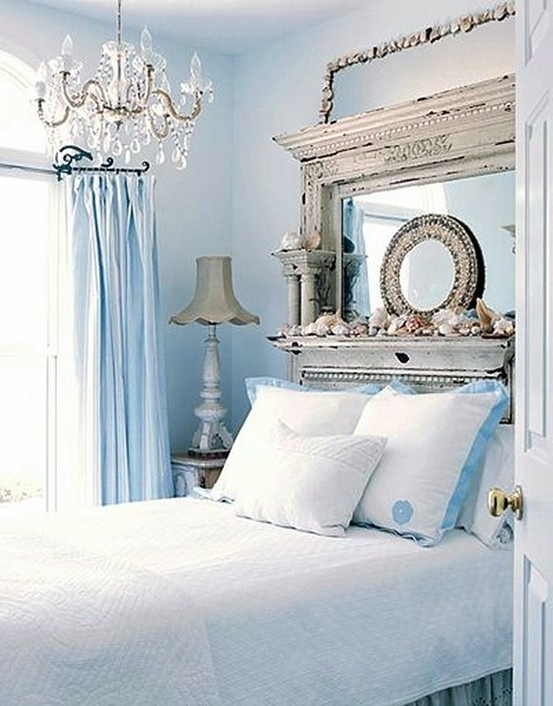 With only a headboard you can set a tone for the whole bedroom. Here is a really unique example  of such headboard.