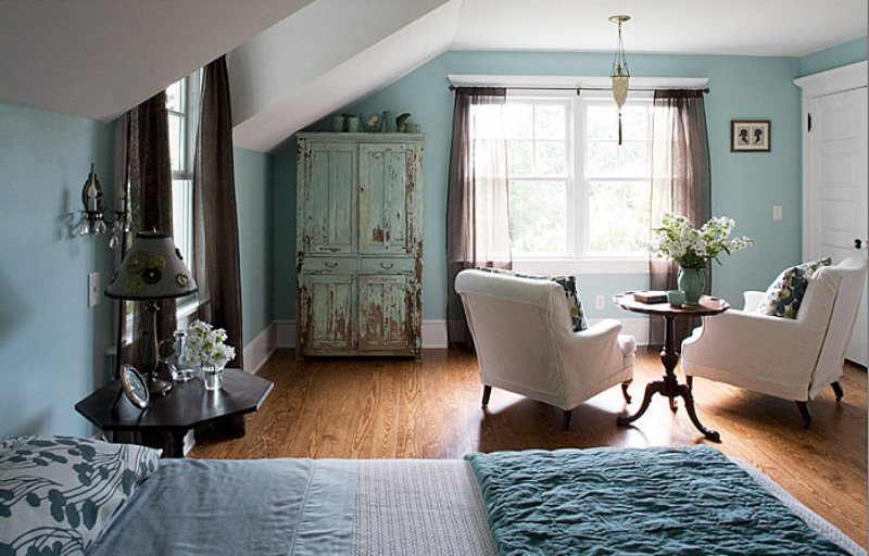 a vintage inspired bedroom in a lighter shade of blue, with touches of creamy, grey and brown