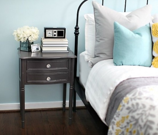 a light blue bedroom and grey, mustard and light blue bedding