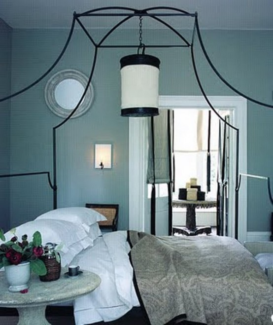 a tiffany blue bedroom in vitnage style, with a large forged bed and grey bedding
