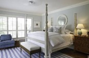 a dove grey vintage-inspried bedroom with touches of bold blue