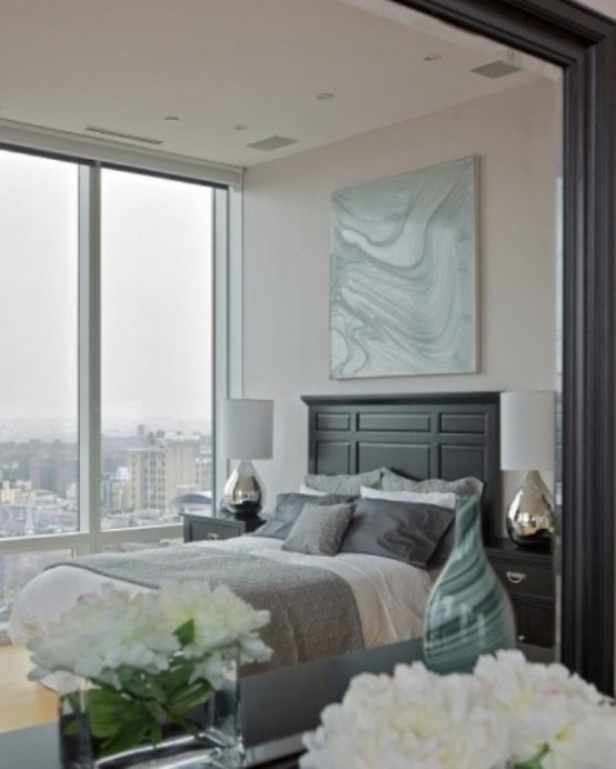 a light grey and creamy bedroom done with touches of tiffany blue