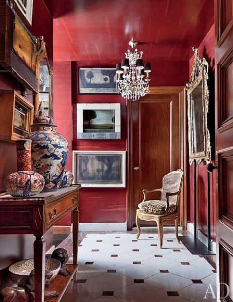 a refined entryway done with burgundy walls   for those who are ready to paint and repaint the spaces