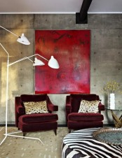 burgundy velvet chairs and a statement red artwork for a bold look in your living room or bedroom