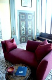 a modern burgundy lounger is a statement idea for a fall-inspired living room