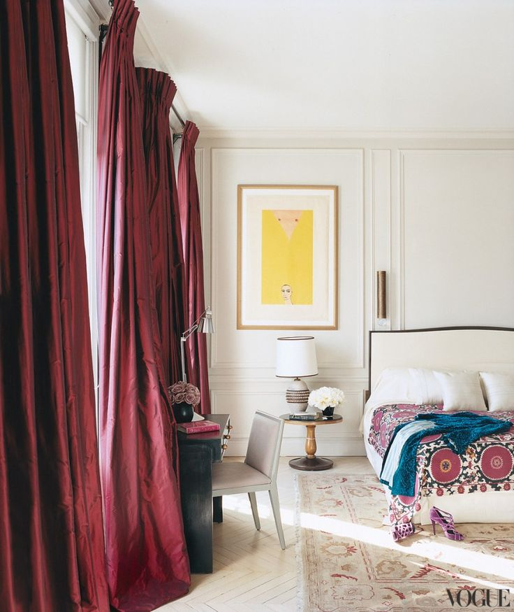 burgundy curtains make a bold statement in the neutral space and add a fall feel to the space