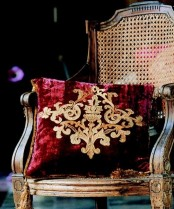 add chic burgundy velvet and gold embroidery pillows to your space for an easy touch of color