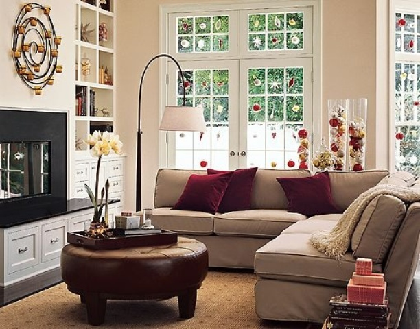 a burgundy leather ottoman and matching pillows will slightly bring a fall feel to the living room