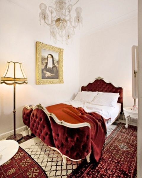 a refined burgundy velvet bed with curved parts looks amazing and very welcoming
