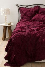 lush burgundy bedding is a great way to bring a fall mood to your bedroom