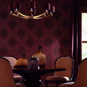 a statement moody wall in burgundy and black is a bold idea to bring fall to your dining room