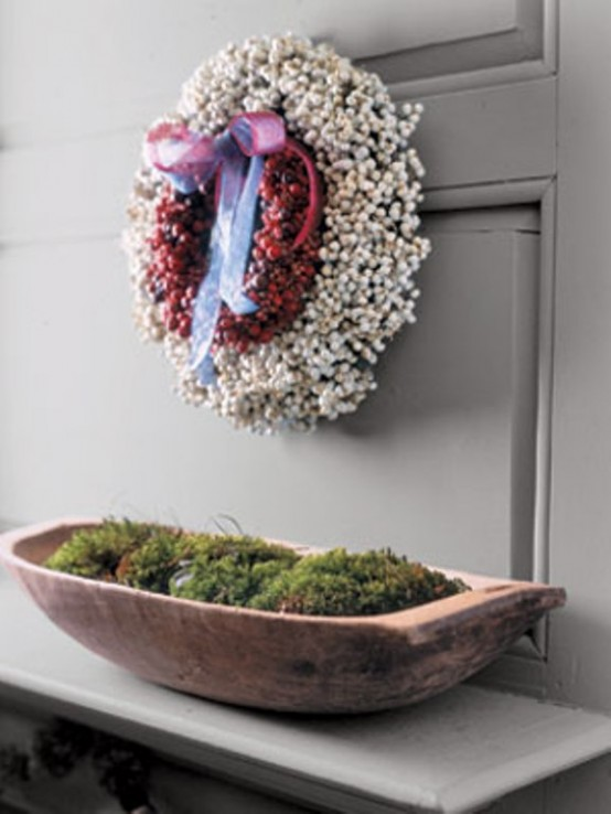 A traditional wreath made from the mix of red and white berries could spruce up your decor for the whole winter.