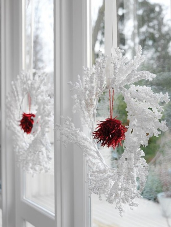 Snowy wreaths are perfect Christmas window decorations.