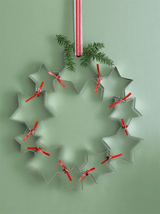 Clean off old cookie cutters for a charming decoration you can hang on any wall you want.