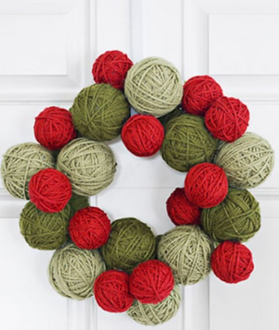 To make this door adornment, wrap Styrofoam balls and a Styrofoam wreath form with colored yarn. Glue everyting together with a hot glue gun. Don't forget to mix different shades of green and red yarn to make the wreath looks special.