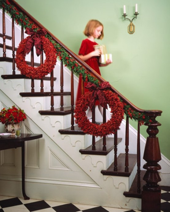 Pops of red looks great not only on windows but on the staircase too.