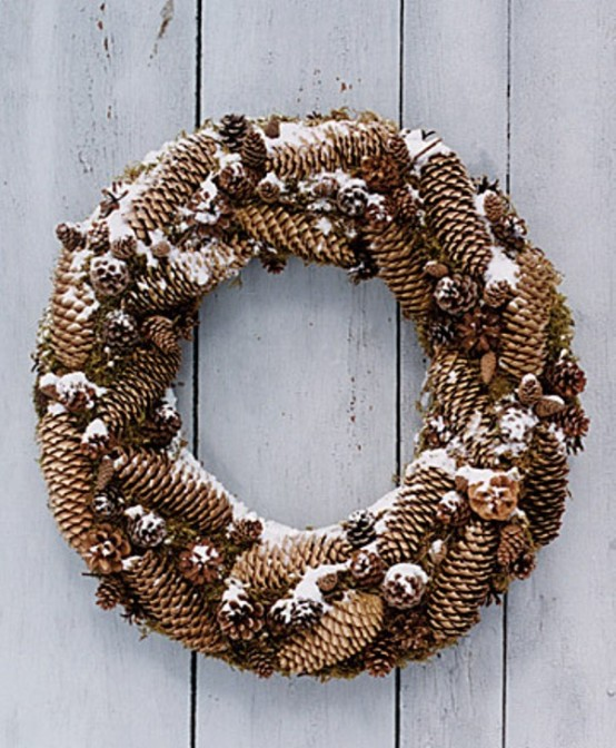 Pinecones is a great material you could use to make a rustic christmas wreath. Add some fake snow to make the wreath to suit winter better.