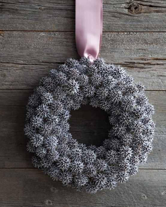 Use hot-glue to adhere pinecones to a grapevine wreath. Apply a light coat of white spray-paint to create a frosted finish.