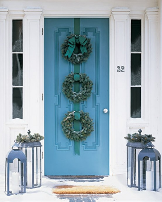 Who said one wreath is enough? Hang several similar wreaths on one door to make it looks special.
