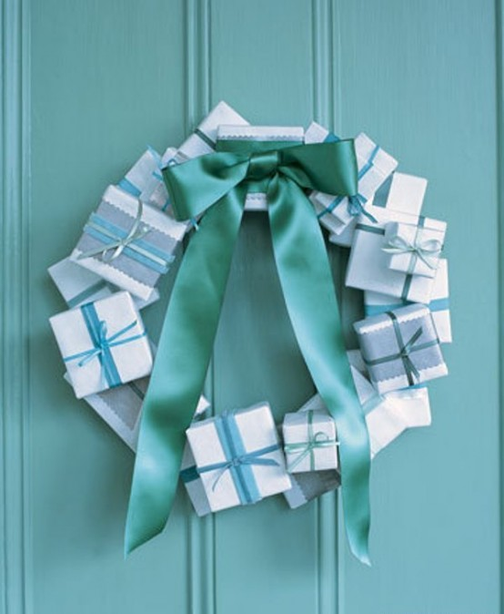 Cover small cardboard boxes with wrapping paper and attach to a flat wooden wreath form using a hot glue gun. A ribbon bow would also be an awesome addition to such wreath.