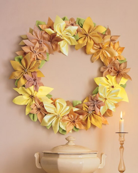Brighten your walls with a wreath made of ribbon. It's great idea to make poinsettias and glue them together to remind the shape of a traditional wreath.