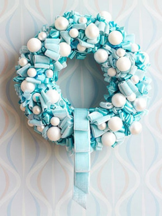 Adding snowballs to ribbon wreath is a great way to add winter touch to its decor.