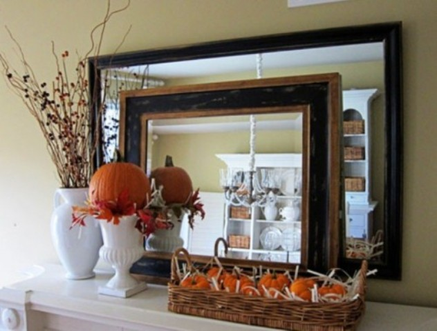 a faux pumpkin arrangement in a basket, a faux pumpkin with leaves in a tall vase and branches in a vase
