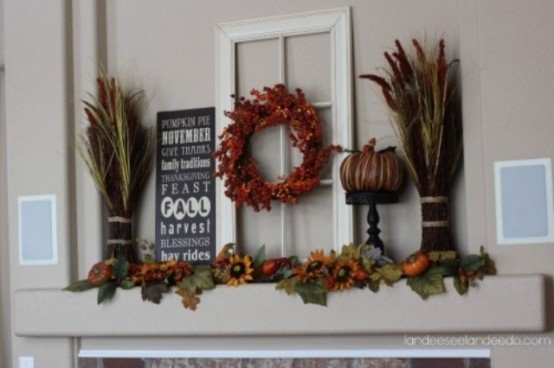 a rustic fall mantel with wheat, fall leaves, faux blooms and pumpkins is all you need to brign a fall feel in