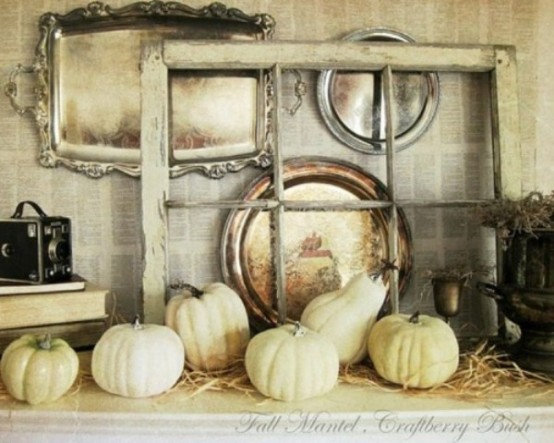 a vintage fall mantel with neutral pumpkins, hay, a vintage window frame, trays, vintage cameras