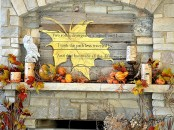 a vintage fall mantel decorated with faux berries, pumpkins, candles, birch branches and owls