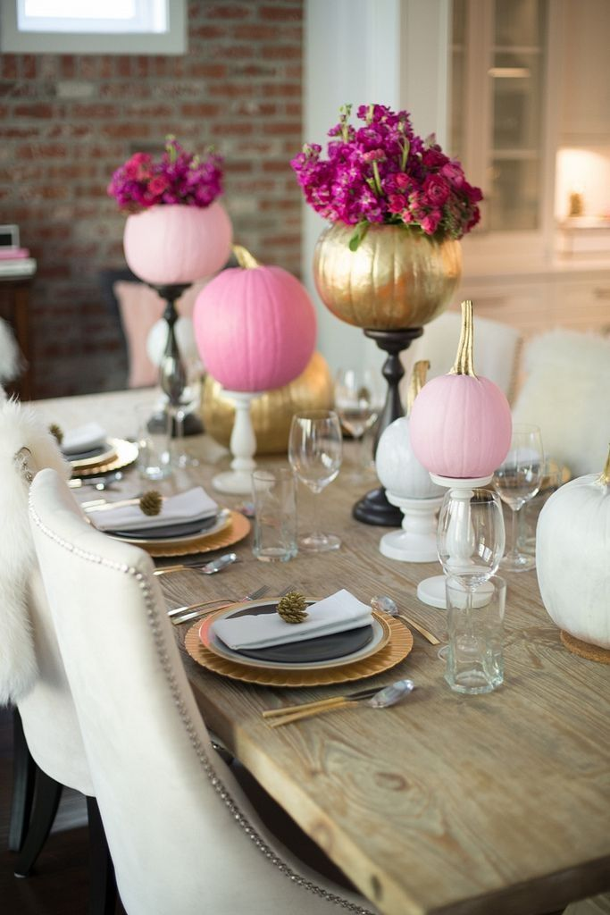 bright pink and gold pumpkins with bold blooms on stands will spruce up your Thanksgiving tablescape