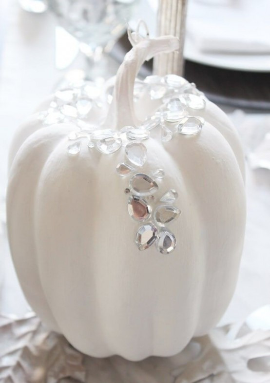 an elegant and glam white pumpkin with rhinestones is a chic and glam Thanksgiving decoration