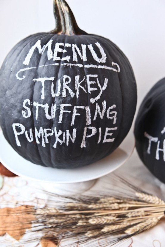 a chalkboard pumpkin can be used as a Thanksgiving party menu or you can chalk something else on it