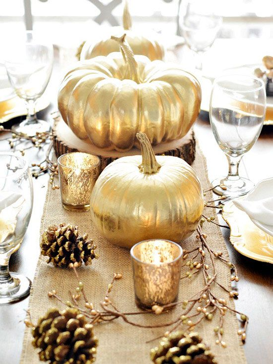 gold pumpkins and pinecones with glitter edges are amazing to decorate your Thanksgiving table