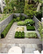 a minimalist townhouse garden with stone tiles, pebbles, stylish plants with no flower beds and a dining set