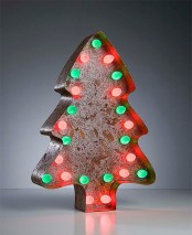 a vintage cookie cutter could become a cool tabletop tree if you add some small light in it