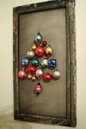 a shabby chic frame with canvas and colorful Christmas ornaments that make up a cool and simple Christmas tree
