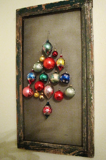 You can make a really nice Christmas tree alternative from glass ornaments and a distressed frame. It's perfect to hang on a wall or put on your mantel to add a rustic touch to your decor.