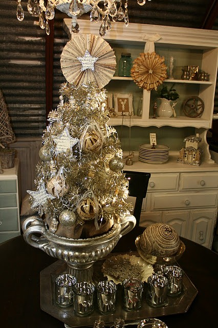 a vintage silver tabletop Christmas tree with various ornaments, paper decor and in a silver bowl